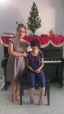 Nhi & her music teacher
