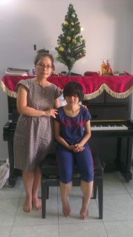 Nhi & her music teacher